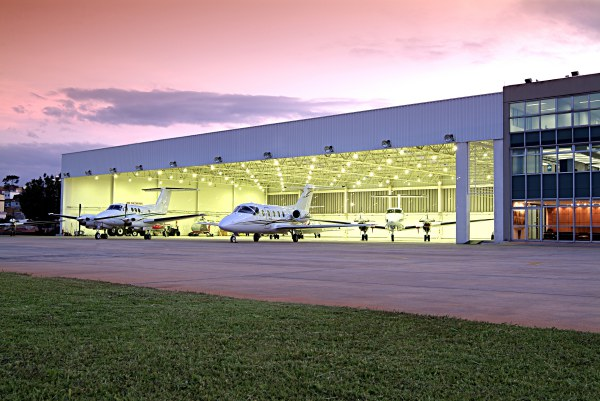 Airplanes parked on the ramp and in the hangar